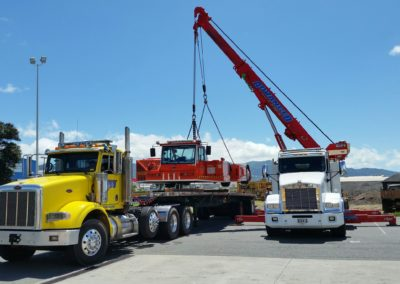 crane loading onto flatbed